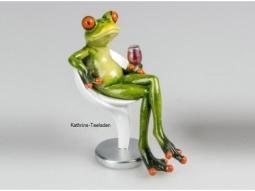 Frosch auf Stuhl mit Weinglas